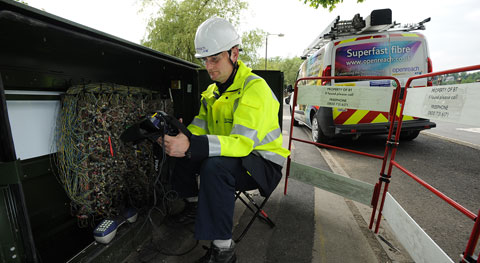 BT engineer upgrading a cabinet for fibre broadband